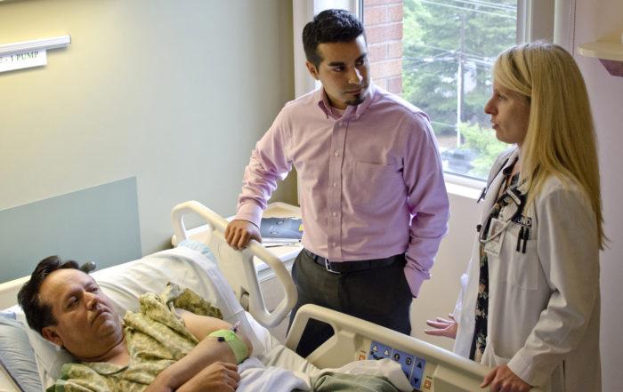 medical interpreter facilitates conversation between hospital patient and provider